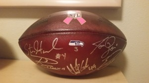 Game ball signed by players and coaches who talked with us!